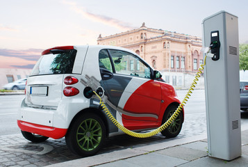 Electro car is charging on the street