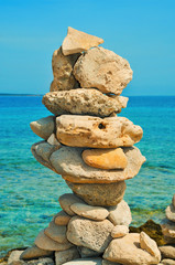balanced stones on the beach in the summer