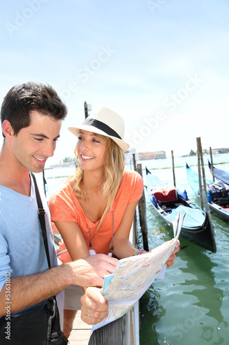 Tourists looking at map in Venice