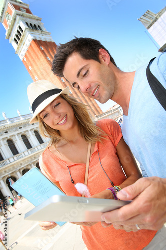 Tourists using tablet in San Marco Piazza in Venice