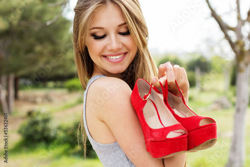 Sexy young woman with red glamour shoes