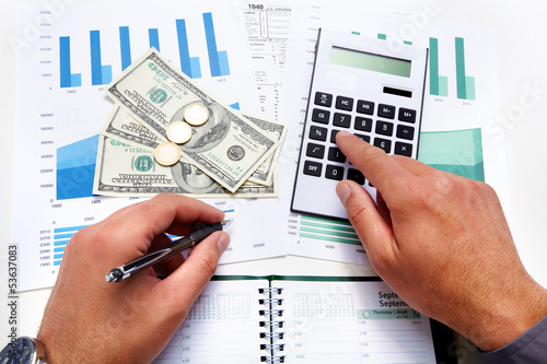Hands of businessman with calculator.