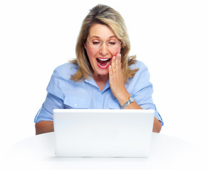 Happy senior woman with laptop computer.
