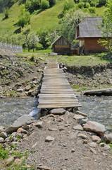 Rustic wooden bridge over a stream