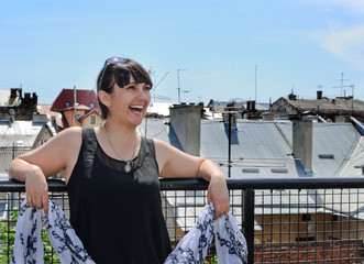 Portrait of a laughing adult woman with cityscape