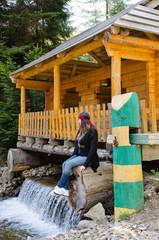 Woman sitting enjoying a pretty waterfall
