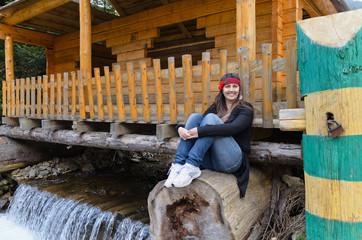 Woman sitting above a waterfall
