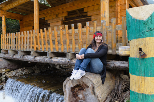 Woman sitting above a waterfall