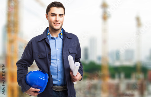 Architect in front of a construction site