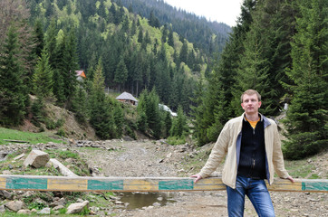 Man standing in a forested valley