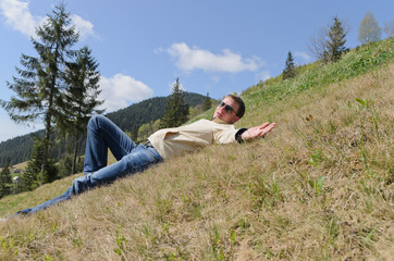 Man relaxing in the mountains