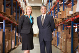 Businesswoman And Businessman In Distribution Warehouse