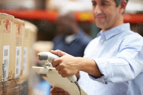 Poster Industrial geb. Worker Scanning Package In Warehouse
