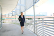 A beautiful businesswoman walking in a business building