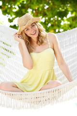 Woman Relaxing In Beach Hammock