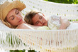 Mother And Daughter Relaxing In Beach Hammock