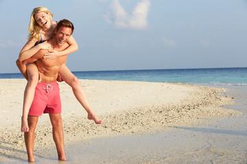 Couple Having Fun On Tropical Beach Holiday