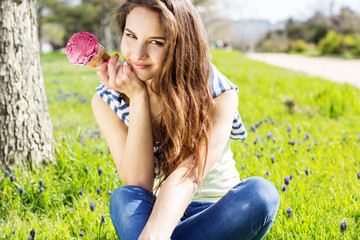 Portrait of young woman eating ice-cream
