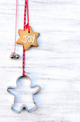 Christmas ornaments hanging against rustic background