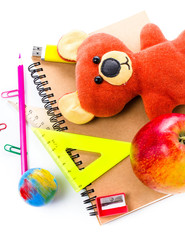 Back to school supplies with Notebook and bear toy on white  bac