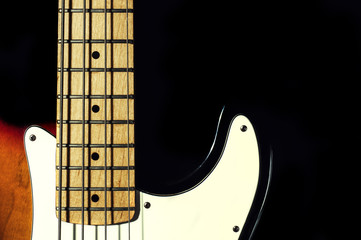 bass guitar on a black background