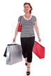 Adult woman with shopping bags isolated.