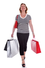 Lady shopper carrying shopping bags isolated.