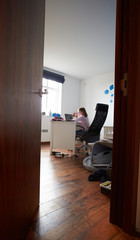 Girl Studying In Bedroom Using Laptop