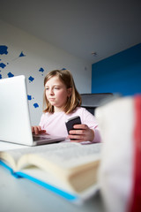 Girl Using Mobile Phone Instead Of Studying In Bedroom