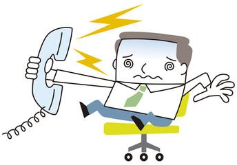 クレームの電話にでるビジネスマン