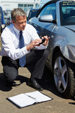 Loss Adjuster Inspecting Car Involved In Accident poster