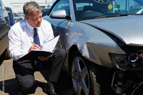canvas print picture Loss Adjuster Inspecting Car Involved In Accident