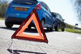 Warning Triangle By Two Cars Involved In Accident poster