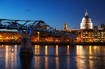 Millennium bridge and St Pauls cathedral at dusk.