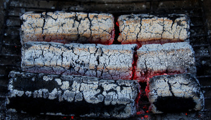 glowing embers from wooden briquettes