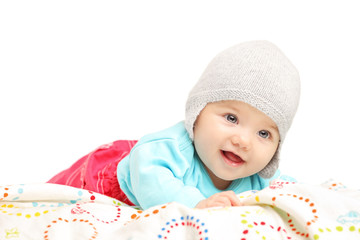 Baby girl with hat lying down