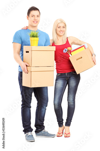 Full length portrait of a young male and female holding boxes
