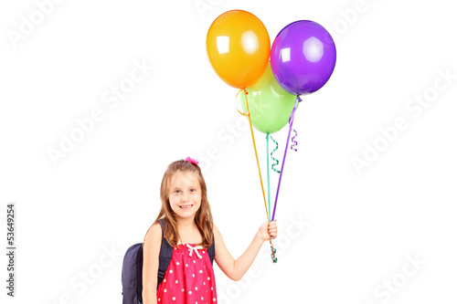 Girl holding a bunch of balloons