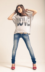 Woman wearing jeans and t-shirt with an inscription love