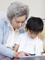 grandma and grandson looking at tablet pc