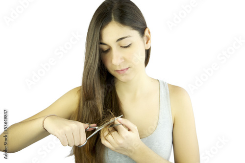 Beautiful woman cutting long dead hair isolated