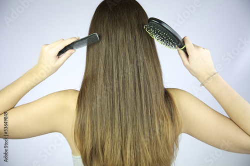 Hair with brush and comb in hand