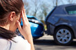 Stressed Driver Sitting At Roadside After Traffic Accident