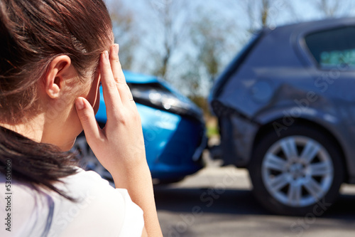 Stressed Driver Sitting At Roadside After Traffic Accident - 53650060