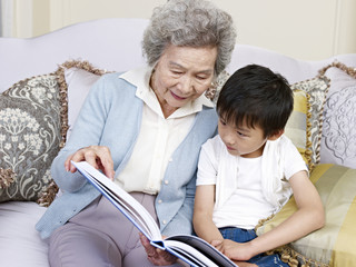 grandma reading a story to grandson