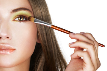 Beauty applying colorful eye makeup