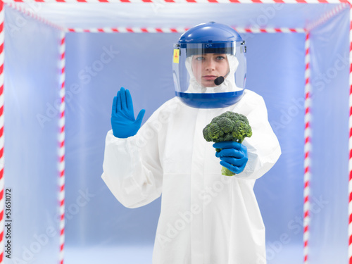 person in biohazard suit warning about contamination