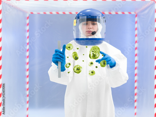 specialist in protective suit holding biological sample