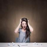 Young desperate girl writing an essay. Conceptual image