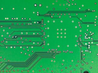 A close-up of a green microprocessor